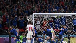 Italy's Leonardo Bonucci, left, celebrates after scoring his side's first goal during the Euro 2020.