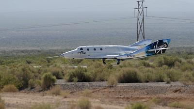 The Virgin Galactic rocket plane, with founder Richard Branson and other crew members on board, lands back in Spaceport America near Truth or Consequences, N.M., July 11, 2021
