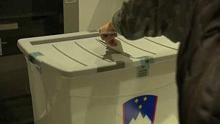 Casting vote in the ballot box, Ljubljana, 11th July 2021.