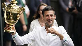 Serbia's Novak Djokovic holds the winner's trophy