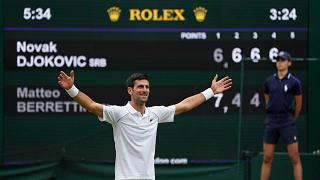 Serbia's Novak Djokovic celebrates his victory over Italy's Matteo Berrettini in the men's singles final at Wimbledon, London, July 11, 2021.