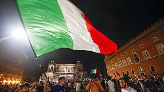 Italy's fans celebrate in Rome, Monday, July 12, 2021, after Italy beat England to win the Euro 2020 soccer championships in a final played at Wembley stadium in London.
