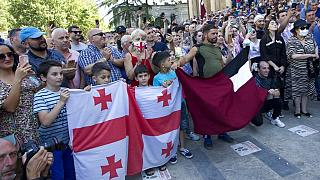 Opponents of the march block off the capital's main avenue to an LGBT march in Tbilisi, Georgia, Monday, July 5, 2021.