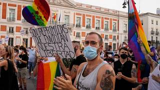 People protest after a spike in attacks on LGBTQ people, Madrid, Spain, Sunday, July 11, 2021.