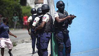 Rendőrök az elnökgyilkosság után Haitin