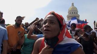 Protesters and police clash in Cuban capital in rare anti-government protest