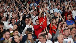 England supporters applaud their team after Sunday's final at Wembley Stadium.