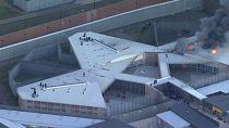 Prisoners in Sydney climb onto prison roof