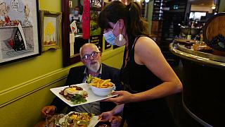 Pierre, 69, enjoys a meal in a restaurant during the nationwide reopening of restaurants, in Lille, northern France, Wednesday, June 9