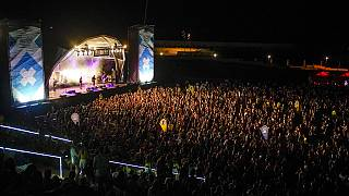 People attend the Cruilla music festival in Barcelona, Spain, Friday, July 9, 2021.