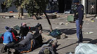 South Africans react to widespread looting and unrest across country