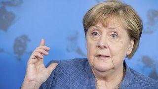 المستشارة الألمانية أنجيلا ميركل تتحدث في مؤتمر صحفي عقب زيارتها لمعهد روبرت كوخ في برلين - ألمانيا/ 13 يوليو 2021.