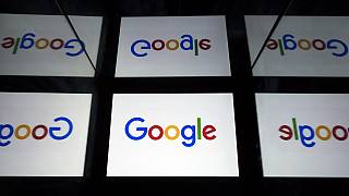 The Google logo displayed on a tablet in Paris