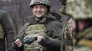 Ukrainian President Volodymyr Zelenskyy talks with servicemen as he visits the war-hit Donetsk region, eastern Ukraine.