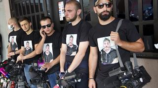 Colleagues of Alexander Lashkarava held a minute of silent during a farewell ceremony in Tbilisi.