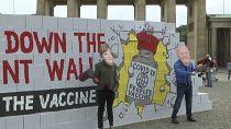 Activists call on Merkel, Biden for jab patents' end