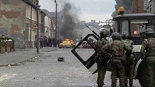 In this May 5, 1981 file photo British troops clash with demonstrators in a Catholic dominated area of Belfast, Northern Ireland, during the period known as 'The Troubles'.
