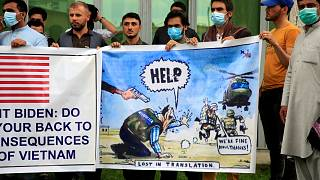 Former Afghan interpreters hold banners during a protest against the U.S. government and NATO in Kabul, Afghanistan on April 30, 2021.