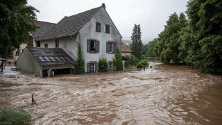Houses are submerged on the overflowed river banks in Erdorf, Germany, as the village was flooded Thursday, July 15