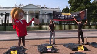 'Free the vaccine': Activists protest outside White House as Biden hosts Merkel