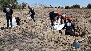 موقع مقبرة جماعية يعتقد أنها تحتوي على جثث مدنيين ومقاتلي تنظيم الدولة الإسلامية في الرقة، سوريا، الأحد 14 تموز/ يوليو 2019