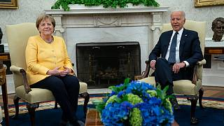 President Joe Biden meets with German Chancellor Angela Merkel in the Oval Office of the White House, Thursday, July 15, 2021, in Washington.