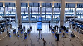 Passengers move about a spacious Terminal B of New York's LaGuardia Airport
