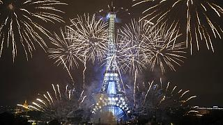 The Eiffel Tower was surrounded by fireworks to mark Bastille Day