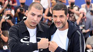 """L'acteur principal Anas Basbousi et le réalisateur Nabil Ayouch du film """"Haut et fort"""" à la 74ème édition du Festival de Cannes"""