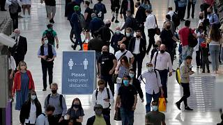 People wear face masks to curb the spread of coronavirus during the morning rush hour at Waterloo train station in London, July 14, 2021.