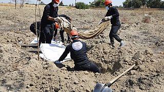 AP Arşiv, Suriye'de toplu bir mezar.