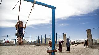 FILE: Children play at al-Hol camp that houses some 60,000 people, including families and supporters of the Islamic State group, Syria, Saturday, May 1, 2021.