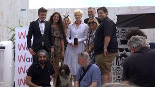 Tilda Swinton and Pam Dog judges and big   posing for photos