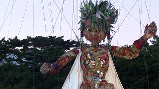 10-metre tall puppet Mocco being raised by a crane