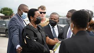 Haiti's first lady Martine Moise, wearing a bullet proof vest and her right arm in a sling, arrives in Port-au-Prince, Haiti, Saturday, July 17, 2021.