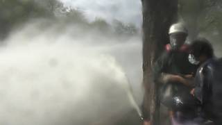 Police firing water canon and tear gas to disperse protesters