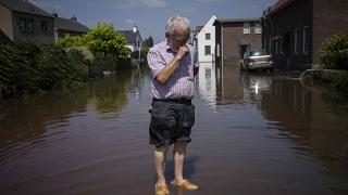Wiel de Bie, 75, stands outside his flooded home in the town of Brommelen, Netherlands.