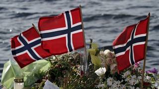 Norwegian flags and flowers are laid in Sundvollen, close to Utoya island in 2011.