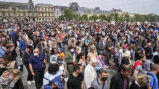 Anti-vaccine protesters march during a rally in Paris, Saturday, July 17, 2021.
