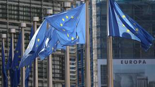 FILE: European Union flags wave in the wind outside EU headquarters in Brussels.