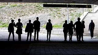 Asylum seeker children pose under a railway bridge in Flen, about 100km south of Stockholm, in August 2018.