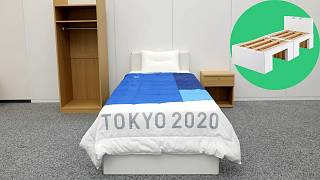 The bed made-up, with the innovative cardboard frame (pictured inset).