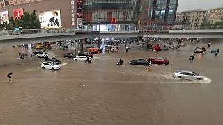 Vehicles are stranded after a heavy downpour in Zhengzhou city, central China