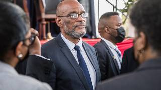 Roiled by presidential assassination, Haiti swears in new PM