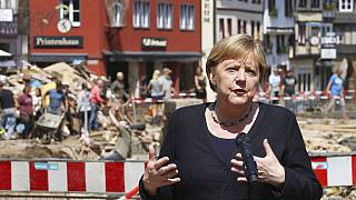 German Chancellor Angela Merkel speaks at a press conference in Muenstereifel, Germany, Tuesday, July 20, 2021.