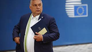 In this Friday, June 25, 2021 file photo, Hungarian Prime Minister Viktor Orban leaves at the end of an EU summit in Brussels.