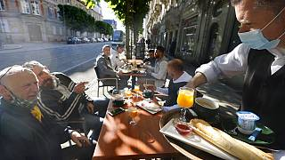 People enjoy a breakfast at a café terrace Wednesday, May, 19, 2021 in Strasbourg, eastern France.