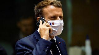 French President Emmanuel Macron speaks on his mobile phone