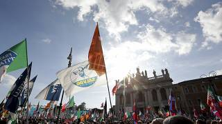 A flag of the Italian League party is seen at a 2019 political rally in Rome.