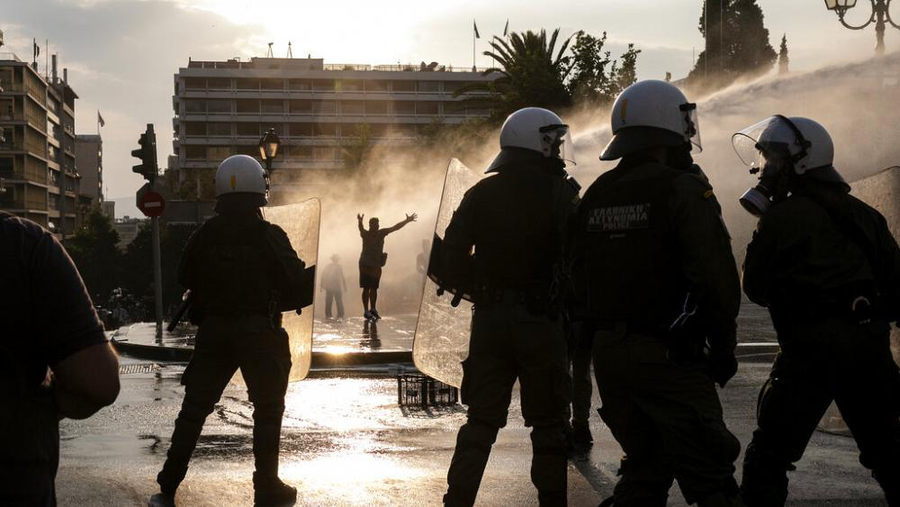 Police use water cannons to disperse Athens protesters as Greek government  ushers in new vaccine law | Euronews